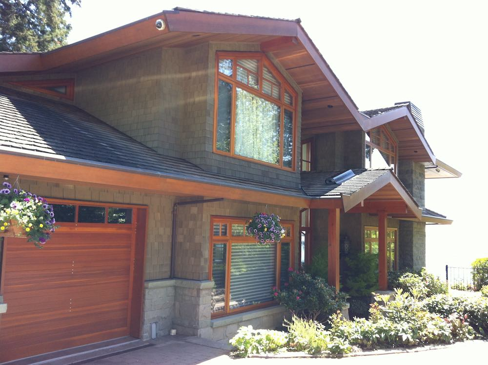 Hidden Gutter Repair | West Vancouver Home - this image shows how the hidden gutters add a home's profile.