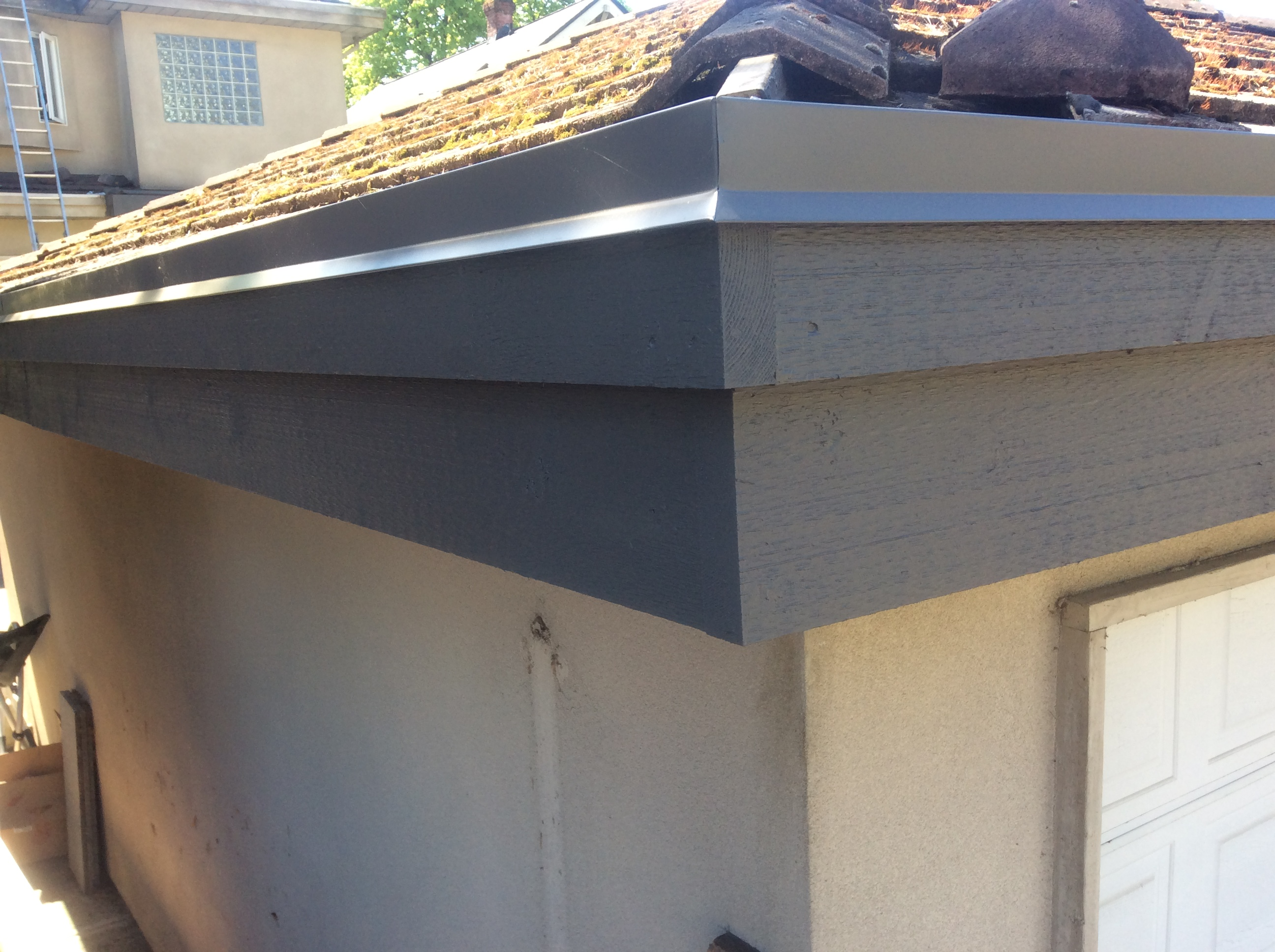 Hidden Gutter Repair for Kitsilano Home - Restored Facia Board and Gutter System